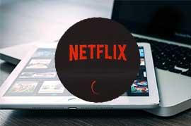 notebook y tablet con Netflix
